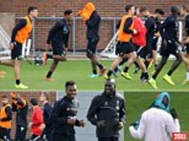 Mario Balotelli STILL struggles to put on a bib as he trains with Liverpool